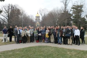 Members of the 2013 Junto in front of the Golden Dome at Notre Dame.